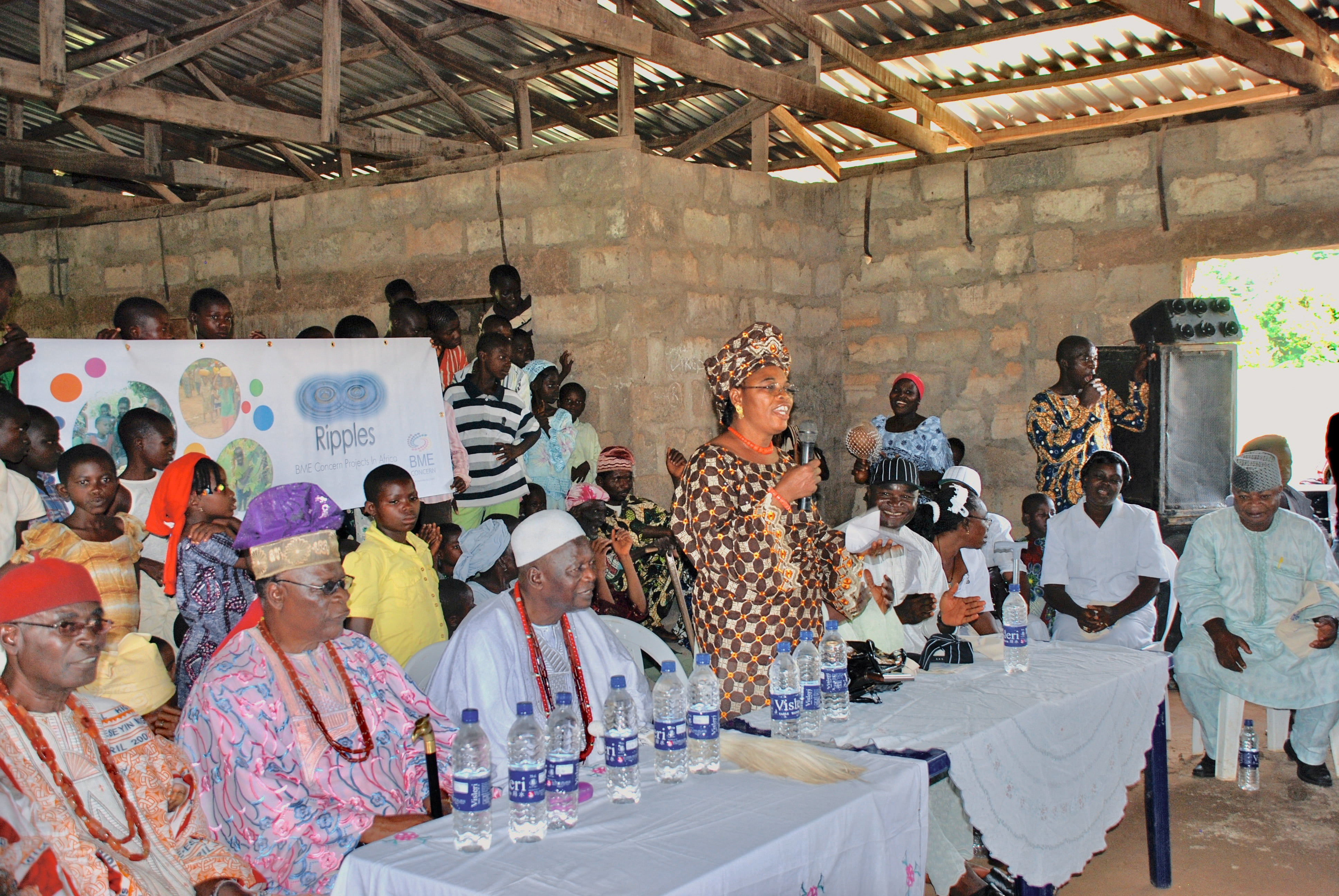 We find causes to support through direct community input. Depicted is a town hall held in Ogidi, Nigeria