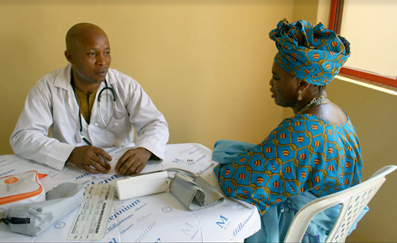 Iyabo, a diabetic, receives a free consultation and treatment from Ripples medical staff.